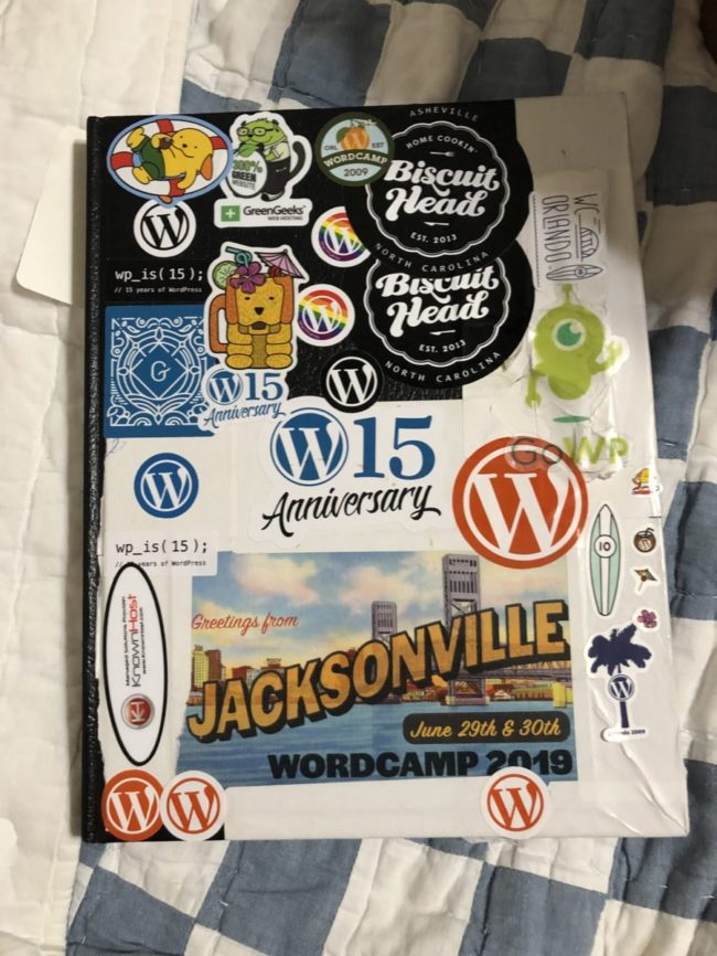 Journal with WordCamp stickers on it