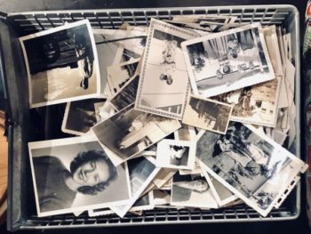 Black-and-white and sepia photos in an inbox made of wire, showing a family morphing and growing over time. PHOTO PROMPT © Ted Strutz