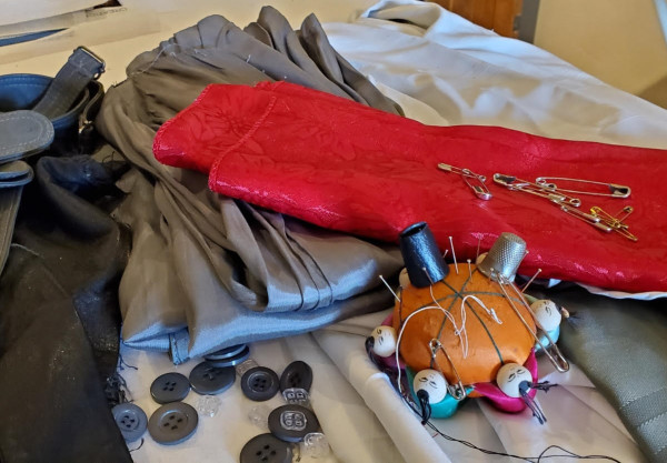 Sewing articles lying on a table. PHOTO PROMPT © Jean L. Hays