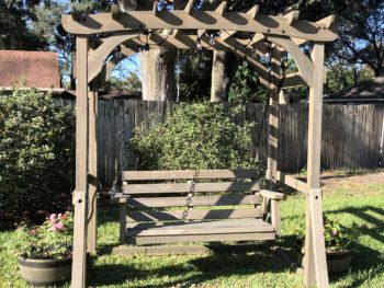 Empty bench swing in the sun. Copyright Andrea LeDew