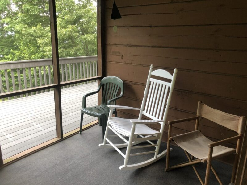 Three chairs on a screen porch, unoccupied, much like the chairs in our schools. Copyright Andrea LeDew.