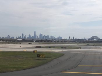 A Newark, New Jersey airport runway with no planes upon it, with the skyline in background. Copyright Andrea LeDew.
