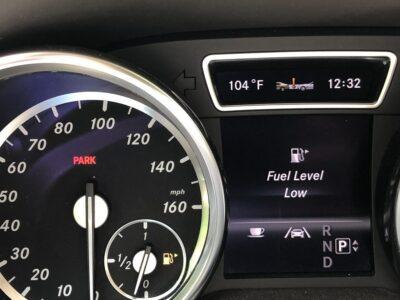 A car dashboard indicating low fuel. Copyright Andrea LeDew.