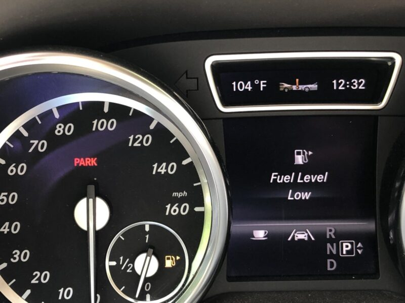 A car dashboard indicating low fuel. Copyright Andrea LeDew.