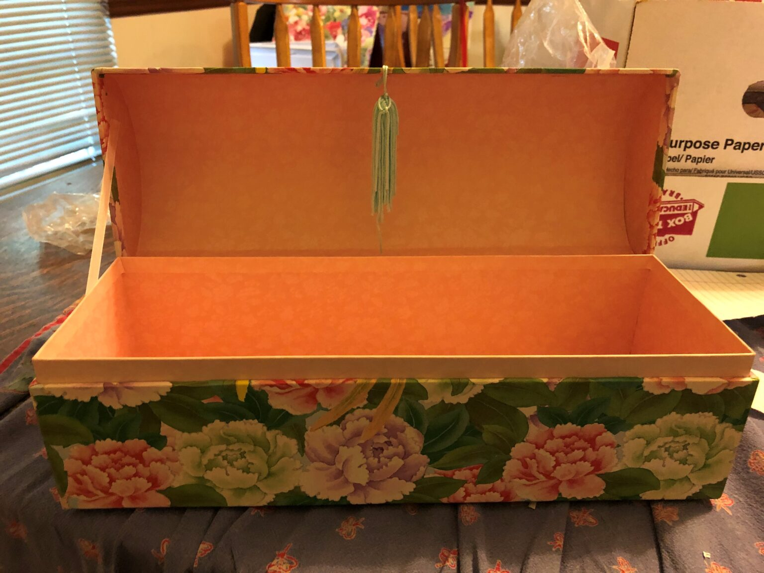 Open pasteboard jewelry box decorated in a floral pattern. Copyright Andrea :LeDew