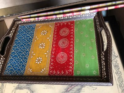 A tray with a colorful bandana print, similar to the kerchiefs often worn by cowboys. Copyright Andrea LeDew.
