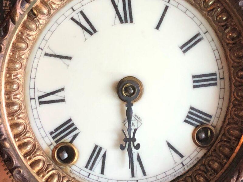 A fancy gilded clock face. Copyright Andrea LeDew