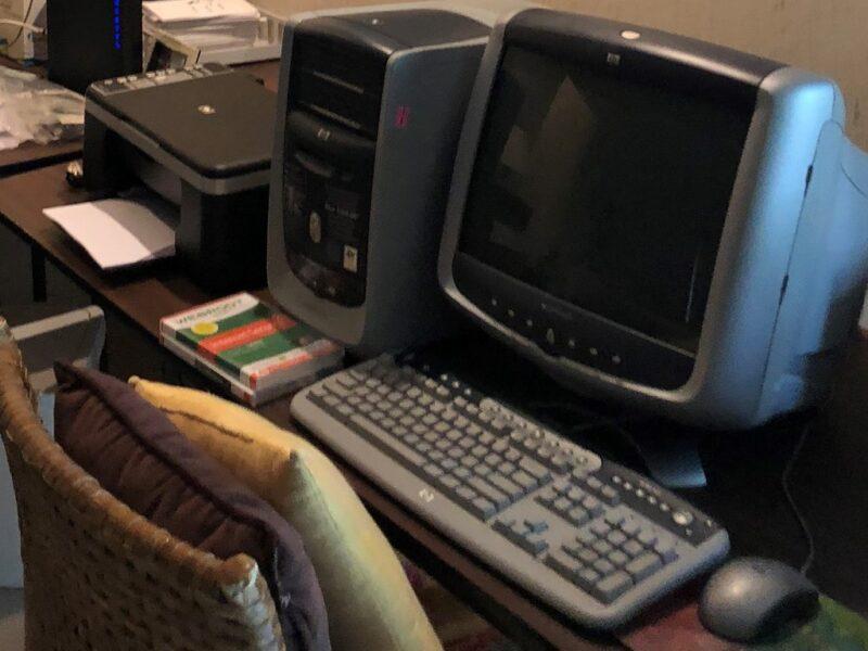 Older computer on desktop. Copyright Andrea LeDew