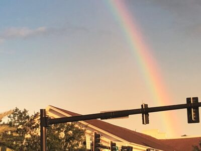 A rainbow that appears to emanate from a traffic intersection. Copyright Andrea LeDew.