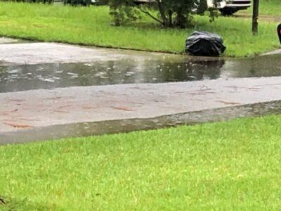 A suburban road just beginning to flood. Copyright Andrea LeDew.