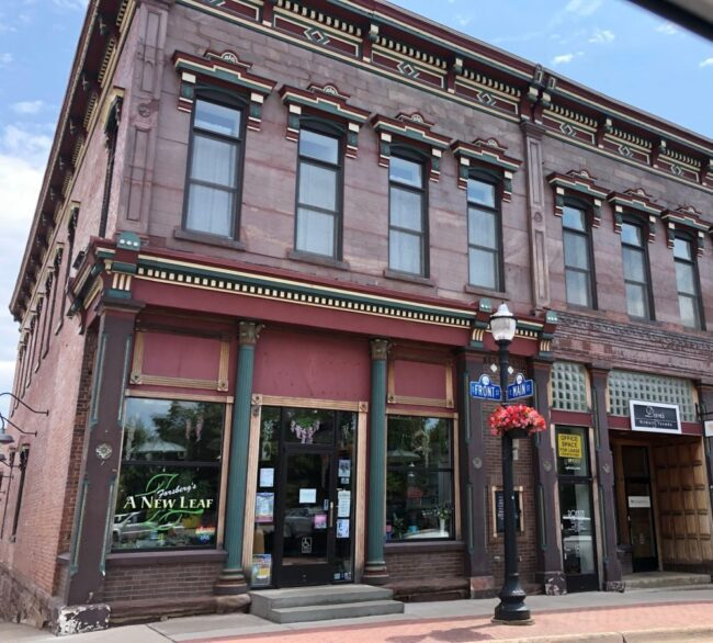 Street corner in Marquette Michigan with fine painted detailing on old brick buildings. Copyright Andrea LeDew.